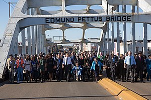 Edmund Pettus Bridge - Then-President Obama, former President George W. Bush, and Civil Rights Movement veterans and other commemoration attendees marching across the Edmund Pettus Bridge in March, 2015