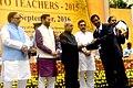 The President, Shri Pranab Mukherjee presenting the National Award for Teachers-2015 to Shri Bijay Kumar Nath (Odisha), on the occasion of the 'Teachers Day', in New Delhi.jpg