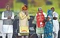The Prime Minister, Shri Narendra Modi distributing the LPG connections to the beneficiaries to mark recognition of 8 districts as Kerosene-free in Haryana, at Haryana Swarna Jayanti Celebrations, in Gurugram, Haryana.jpg