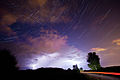 The constellation of Cassiopeia over a thunderstorm.jpg