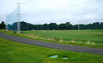 English: The driving range High fencing to pro...