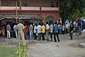 The men voters standing in a queue for casting their votes, at a polling booth, during the 5th Phase of General Elections-2014, at Jalpaiguri on April 17, 2014.jpg