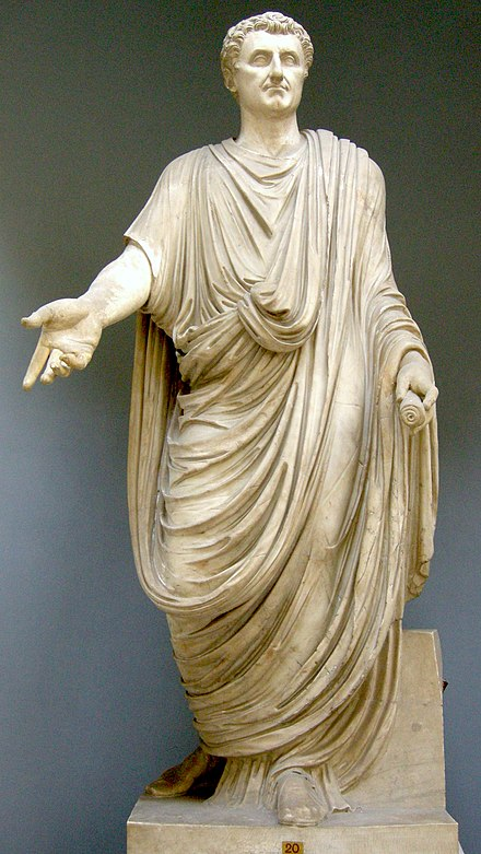 The toga, shown here on a statue restored with the head of Nerva, was the distinctive garb of Roman male citizens. Togato, I sec dc. con testa di restauro da un ritratto di nerva, inv. 2286.JPG
