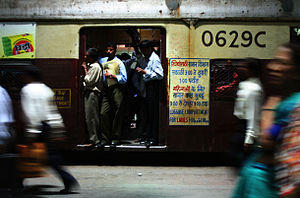Commuters in an open train door at Churchgate ...