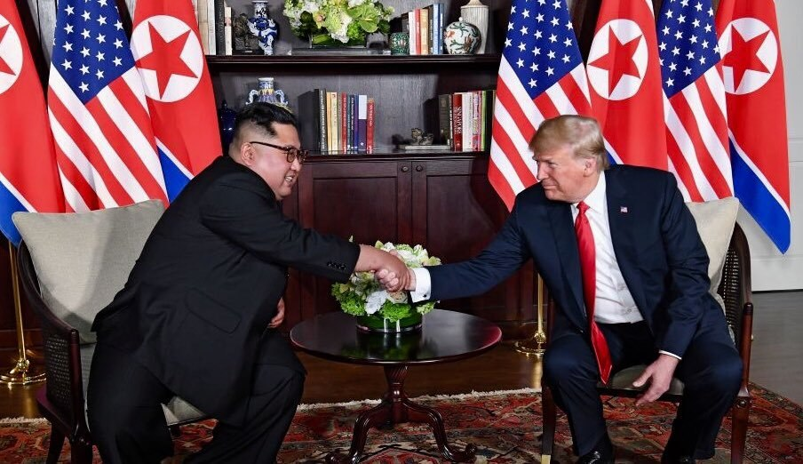 Trump and Kim shaking hands in the summit room
