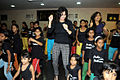 Tulip Joshi interacts with young girls at Arts in Motion's 'Dance with Joy' event 04.jpg