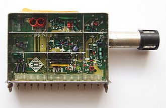 Tuner (radio) - Opened VHF/UHF tuner of a television set. The antenna connector is on the right.