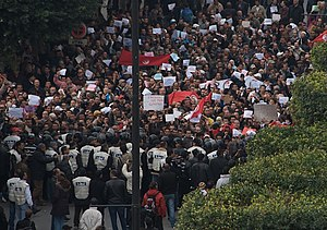 Timeline of Tunis - Protesters and police on Avenue Bourguiba, Tunis, January 2011