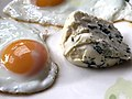 Two eggs with blue cheese on a plate.jpg