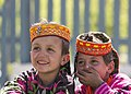 Two little Kalash girls sharing happiness.jpg
