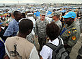 U.S. Air Force Gen. Douglas Fraser, commander of U.S. Southern Command, listens to members of nongovernmental organizations at Ancien Aeroport Militaire in Port-au-Prince, Haiti, March 6, 2010 100306-N-HX866-016.jpg