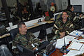 U.S. Air Force Lt. Col. Michael Hudson and Col. Deane Pennington, both of the 169th Fighter Wing, man the installation control center during a phase II operational readiness evaluation at McEntire Joint National 080411-F-WT236-007.jpg