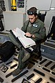 U.S. Air Force Tech. Sgt. J. R. Moyer, a loadmaster with the 326th Airlift Squadron, 512th Airlift Wing, reviews C-17 Globemaster III aircraft maintenance forms before a training mission at Dover Air Force Base 130618-F-VV898-001.jpg