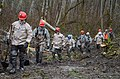 U.S. Airmen with the Washington Air National Guard walk away from mudslide wreckage after spending the day removing debris and searching for missing persons in Oso, Wash., March 27, 2014 140327-Z-ZZ999-009.jpg