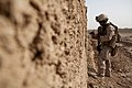 U.S. Marine Corps Capt. Ernesto Howard, an assistant officer in charge of the Supporting Arms Liaison Team, 2nd Air Naval Gunfire Liaison Company, takes notes during a patrol in Charabiya, Helmand province 130808-M-RF397-072.jpg