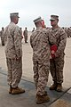 """U.S. Marine Corps Col. Patrick Gramuglia, center, commanding officer of Marine Aircraft Group (MAG) 16, 3rd Marine Aircraft Wing (MAW), awards the Bronze Star with combat distinguishing """"V"""" device, for valor, to 130617-M-EF955-033.jpg"""