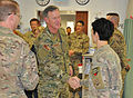 U.S. Navy Adm. William H. McRaven, center, the commander of U.S. Special Operations Command, exchanges greetings with emergency room staff members at the Heathe N. Craig Joint Theater Hospital during 131128-F-UR349-002.jpg