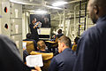 U.S. Navy Chief Electrician's Mate Xiaocong Li, standing center, gives engineering training aboard the guided missile destroyer USS Truxtun (DDG 103) in the Atlantic Ocean Aug. 7, 2013 130807-N-YZ751-004.jpg