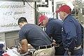 U.S. Navy Cmdr. Dennis Volpe, center, executive officer and team leader of damage control training, and Chief Damage Controlman David Helegda, right, team coordinator with damage control training, observe Lt 120809-N-XQ232-1896.jpg