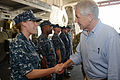 U.S. Navy Petty Officer 1st Class Rachel Preston, left, shakes hands with Secretary of Defense Chuck Hagel as he tours the USS Freedom (LCS 1) in Singapore on June 2, 2013 130602-N-PD773-148.jpg