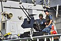 U.S. Sailors aboard the guided missile destroyer USS Russell (DDG 59) prepare to leave Joint Base Pearl Harbor-Hickam, Hawaii 130103-N-RI884-017.jpg