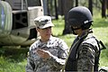 U.S Army Capt. Loraima Morciglio, left, a lawyer with U.S. Army South Judge Advocate General, advises a Guatemalan student during a training exercise in Guatemala, June 11, 2013 130611-A-TQ625-024.jpg