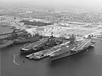 USS Enterprise (CVN-65), USS Coral Sea (CV-43) and USS Oriskany (CV-34) docked at Naval Air Station Alameda on 10 July 1975 (K-109619).jpg