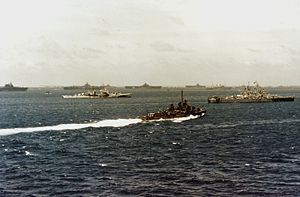 Ulithi - U.S. naval forces including carriers in the distance at anchor in Ulithi, March 1945