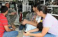 US Army 53598 'Strykehorse' Soldiers get young visitors during YA09.jpg