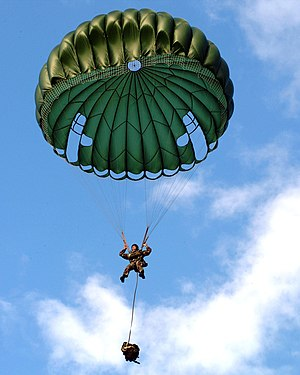 Explosive ordnance disposal (United States Navy) - Member of Explosive Ordnance Disposal Mobile Unit Five jumps from a CH-46 using a MC1-1C parachute