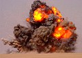 US Navy 020712-N-5471P-010 EOD teams detonate expired ordnance in the Kuwaiti desert.jpg