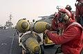 US Navy 030327-N-1810F-024 Aviation ordnancemen transfer GBU-31 joint defense attack munitions (JDAM) to ready Carrier Air Wing Five (CVW-5) aircraft.jpg