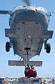 US Navy 030427-N-5781F-002 An SH-60 Seahawk hovers above flight deck aboard USS Kitty Hawk (CV 63), offloading ammunition to the ammunition ship USNS Flint (T-AE 32) during a vertical replenishment.jpg