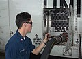 US Navy 040226-N-8055R-080 Aviation Machinist Mate 3rd Class Jeremy Reinhardt, of Pacifica, Calif., conducts a refueling operations on a C-130T Hercules.jpg