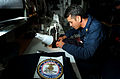 US Navy 040603-N-6213R-005 Boatswain's Mate 1st Class James Stout sews in the ships sail loft aboard the aircraft carrier USS John C. Stennis (CVN 74).jpg