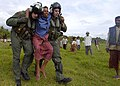 US Navy 050103-N-6020P-206 Two Naval Air crewmen carry a seriously injured Indonesian woman to a waiting helicopter for transportation to a medical facility.jpg