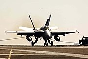 US Navy 050129-N-6074Y-080 An F-A-18C assigned to Vigilantes of Strike Fighter Squadron One Five One (VFA-151), makes an arrested landing on the flight deck of the Nimitz-class aircraft carrier USS Abraham Lincoln (CVN-72.jpg