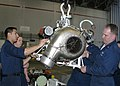 US Navy 050415-N-3122S-014 Aviation Machinist Mates, assigned to the Tigers of Patrol Squadron Eight (VP-8), work together to lower an auxiliary power unit (APU) of a P-3C Orion during maintenance.jpg
