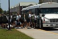 US Navy 050708-N-0000Z-002 Students assigned to Naval Aviation Technical Training Center (NATTC) load onto buses as they prepare to evacuate.jpg