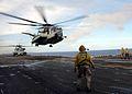 US Navy 060219-N-2970T-018 Aboard the amphibious assault ship USS Essex (LHD 2), two CH-53E Super Stallions belonging to Marine Air Combat Element (HM) 262 depart the flight deck.jpg