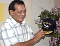 US Navy 060528-N-3153C-020 The Honorable Mayor of Zamboanga, Celso Lobregat, receives a Mercy ball cap during his first tour board the Military Sealift Command (MSC) hospital ship USNS Mercy (T-AH 19).jpg