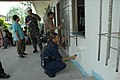 US Navy 060531-N-1577S-162 Navy Yeoman 3rd Class Adelaida Sojo lends a hand to the crew of Naval Mobile Construction Battalion Four Zero (NMCB-40) painting the pediatric ward at the Zamboanga Medical Center.jpg