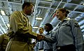 US Navy 061205-N-7130B-056 Capt. Terry Kraft, commanding officer aboard USS Ronald Reagan (CVN 76), congratulates Yeoman 2nd Class Heidi Spoonheim during an advancement ceremony held in the ship's hangar bay.jpg