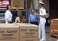 US Navy 070309-N-5013K-330 USS Blue Ridge (LCC 19) Commanding Officer Capt. Jeff Bartkoski discusses Project Handclasp and the Blue Ridge mission with the heads of relief organizations in Indonesia during a turnover of donated.jpg