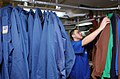 US Navy 070312-N-4009P-188 Aviation Boatswain's Mate Equipment Seaman Anthony Munoz from Fresno, Calif., hangs a chief's flight deck jersey in the laundry room aboard Nimitz-class aircraft carrier USS Ronald Reagan.jpg