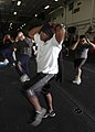 US Navy 070315-N-1226D-043 Intelligence Specialist 1st Class Travoric Smith from Odessa, Texas, exercises during the Fitness Enhancement Program aboard USS Bonhomme Richard (LHD 6) hangar bay.jpg