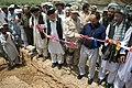 US Navy 070802-N-3385W-766 Commanding Officer Provincial Reconstruction Team Khost, U.S. Navy Cmdr. David Adams and the Governor of Afghanistan's Khowst province, Arsala Jamal cut the ribbon to the construction project fo.jpg