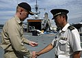 US Navy 070911-N-8487G-027 Capt. Kent D. Whalen, commanding officer of amphibious transport dock USS Juneau (LPD 10), left, presents a ship's coin to Capt. Yasuhiro Matsuo, of the Japan Ground Self Defense Force (JGSDF),.jpg