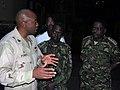 US Navy 071213-N-6708W-145 Capt. Fernandez Ponds, commander, Kearsarge Strike Group, explains wet-well operations to Lt. Col. John Kasaija, of the Ugandan Peoples Defense Force, and Col. Joseph Michie, of the Kenyan Army.jpg