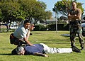 US Navy 080116-N-8607R-068 Department of Defense police and active duty and reserve service members subdue a suspect as part of the pepper spray certification course at Naval Base Ventura County.jpg